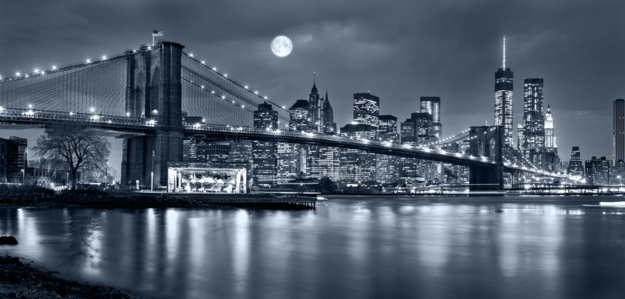 Black & White Photo of Full Moon Over Manhattan.