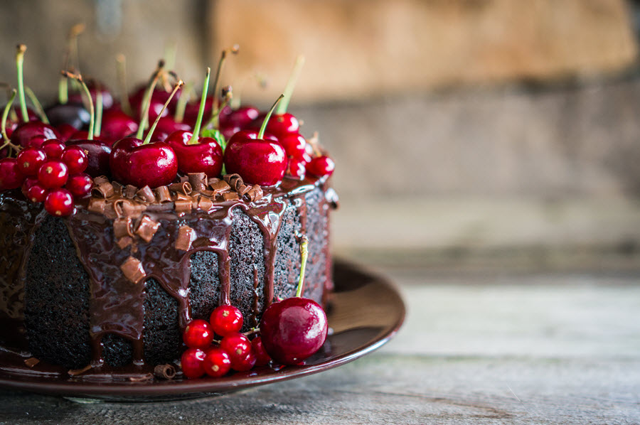 Chocolate Cake with Cherries on Top.